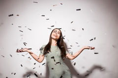 teen girl in fancy dress with sequins and confetti at party Royalty Free Stock Images