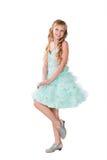 Teen girl in fancy gown dancing isolated Stock Photos