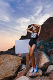 Teen girl fashion shoot at sunset beach with empty Royalty Free Stock Image