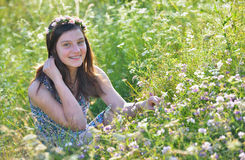 Teen girl in a field Royalty Free Stock Photo