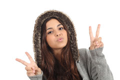 Teen girl with the fingers in victory sign. Teen girl with hood and the fingers in victory sign on a white background Royalty Free Stock Photos