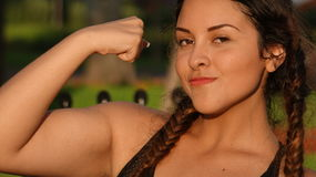 Teen Girl Flexing Muscles Stock Image