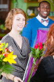 Teen Girl in Flower Shop Buys Roses Royalty Free Stock Image