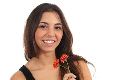 Teen girl with a flower smiling Stock Image