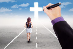 Teen girl follow a cross on the road Stock Photo