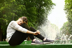 Teen girl fountain background close up photo Stock Photos