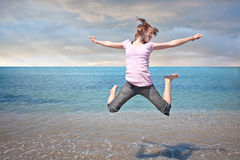 Teen girl freedom jump in water Stock Photos