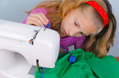 Teen girl frightened by her mistake when sewing Stock Photography