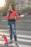 Teen girl with fruity fresh and skateboard stock photography