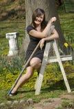 Teen girl with garden tools smiles Stock Image
