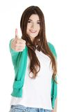 Teen girl gesturing thumbs up Royalty Free Stock Photo