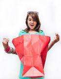 Teen girl with gift bags looking inside Royalty Free Stock Photos