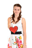 Teen girl giving a red glitter heart Stock Photography