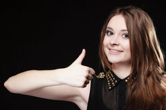 Teen girl giving thumbs up sign on black Stock Photos