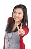 Teen Girl Giving Victory Sign Stock Photo