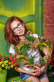 Teen girl with glasses holding bouquet of flowers. Stock Image