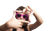 Teen girl with glasses make frame with her fingers Royalty Free Stock Photography