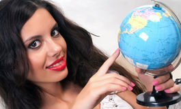 Teen girl with globe Royalty Free Stock Photos