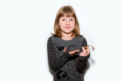 Teen girl with golden watches Royalty Free Stock Images