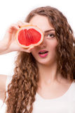 Teen girl with grapefruit in hands Stock Images