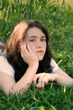 Teen girl in grass 2 Royalty Free Stock Photo