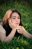 Teen girl in grass 3 Stock Images