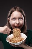 Teen girl greedily eating Stock Photo