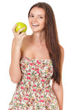 Teen girl with green apple Royalty Free Stock Images