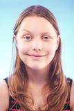 Teen girl grimacing Stock Image