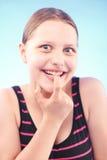 Teen girl grimacing Stock Images