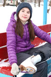 Teen  girl  hair put on ice skate boots Stock Image