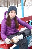Teen  girl  hair put on ice skate boots Stock Images