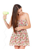 Teen girl with hairdryer Royalty Free Stock Images