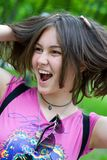 Teen girl with hands in her hair. Laughing Stock Photos