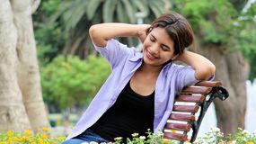 Teen Girl And Happiness Sitting On Bench Stock Photography