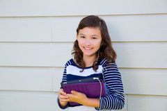 Teen girl happy holding tablet pc and earings Stock Images
