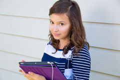 Teen girl happy holding tablet pc and earings Stock Image
