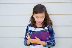 Teen girl happy holding tablet pc and earings Stock Photos