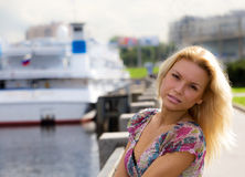 Teen girl at harbour. Blonde teen girl at cruise harbour Royalty Free Stock Photo
