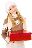 Teen girl in a hat holding a gift Royalty Free Stock Photography