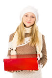 Teen girl in a hat holding a gift isolated Royalty Free Stock Photos
