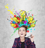 Teen girl having an aha moment, light bulbs Royalty Free Stock Images