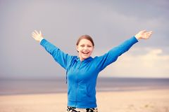 Teen girl having fun on the beach Stock Images