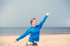 Teen girl having fun on the beach Stock Image
