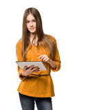 Teen girl having fun with tablet computer. Portrait of a gorgeous teen girl having fun with tablet computer Royalty Free Stock Photos