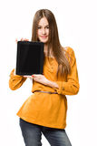 Teen girl having fun with tablet computer. Portrait of a gorgeous teen girl having fun with tablet computer Royalty Free Stock Image