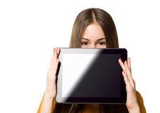 Teen girl having fun with tablet computer. Stock Photo