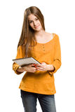 Teen girl having fun with tablet computer. Royalty Free Stock Images