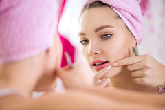 Teen girl having pimple Stock Photos
