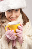 Teen girl having tea Stock Photography